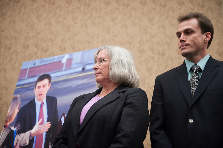UNITED STATES - JULY 20: From left,  Gabe Zimmerman's mother Emily Nottingham, and Gabe Zimmerman's brother Ben Zimmerman, listen to remarks during the news conference on Wednesday, July 20, 2011, to announce efforts to rename room HVC 215 after slain congressional staff member Gabe Zimmerman. (Photo By Bill Clark/Roll Call)