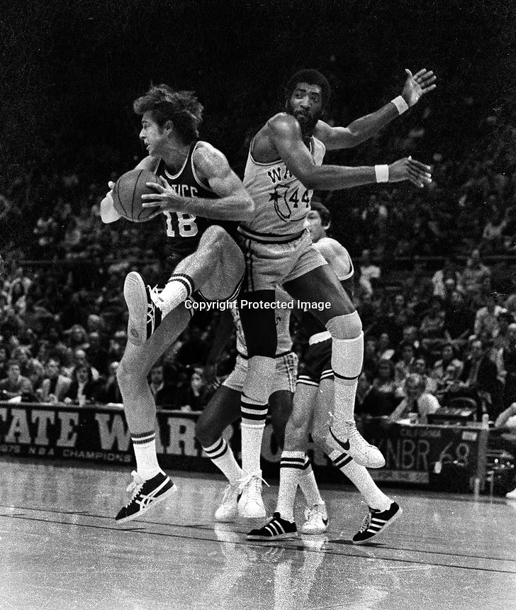 Warriors vs Boston Celtics...Clifford Ray battles Dave Cowens for rebound. (1977 photo/Ron Riesterer)