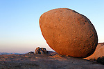 Sunset illuminates an egg-shaped rock at Joshua Tree National Park
