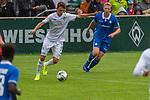 13.07.2019, Parkstadion, Zell am Ziller, AUT, FSP, Werder Bremen vs. Darmstadt 98<br /> <br /> im Bild / picture shows <br /> <br /> Benjamin Goller (Neuzugang Werder Bremen #39) LEON MÜLLER / LEON MUELLER (DARMSTADT 98 #34) auf den weg zum Tor zum 1:1<br /> Foto © nordphoto / Kokenge