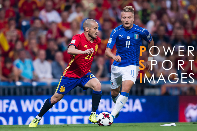 David Silva (L) of Spain fights for the ball with Ciro Immobile (R) of Italy during their 2018 FIFA World Cup Russia Final Qualification Round 1 Group G match between Spain and Italy on 02 September 2017, at Santiago Bernabeu Stadium, in Madrid, Spain. Photo by Diego Gonzalez / Power Sport Images