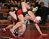 Dan Colondona of Connetquot, top, controls Kevin DePalma of Farmingdale at 113 pounds during the final round of the 2016 Ted Petersen Tournament at Island Trees High School on Saturday, Jan. 2, 2016. Colondona won the match.