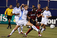 The  Wizard's Jimmy Conrad  tackles the ball away from the  MetroStars' Fabian Taylor. The Kansas City Wizards were defeated by  the NY/NJ MetroStars to a 1 to 0 at Giant's Stadium, East Rutherford, NJ, on May 30, 2004.