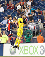 New England Revolution defender Kevin Alston (30) and Columbus Crew forward Eddie Gaven (12) battle for head ball. In a Major League Soccer (MLS) match, the New England Revolution defeated Columbus Crew, 2-0, at Gillette Stadium on September 5, 2012.