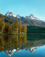 Grand Teton, Mount Owen and Teewinot Mountain reflected in Taggart Lake, Grand Teton National Park, Wyoming