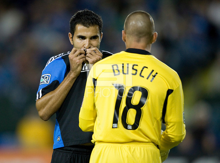 Earthquakes goalkeeper Jon Busch talks with Steven Beitashour during the game against Kansas City at Buck Shaw Stadium in Santa Clara. California on October 1st, 2011.  San Jose Earthquakes tied Sporting Kansas City, 1-1.