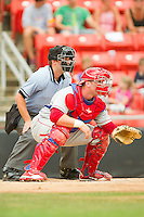 Catcher Jeff Lanning #24 of the Lakewood BlueClaws sets his target as home plate umpire Blake Felix looks over his shoulder during the game against the Hickory Crawdads at L.P. Frans Stadium on June 5, 2011 in Hickory, North Carolina.   Photo by Brian Westerholt / Four Seam Images