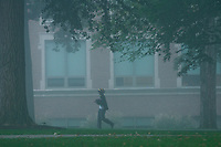 Otterbein University students travel to class across fog-shrouded walkways and streets of a fall day warming after a cold, wet weekend.