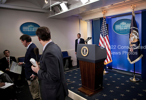 TV reporters look as United States President Barack Obama arrives to make a statement in the press briefing room of the White House, Friday, October 29, 2010 in Washington, DC.  President Obama spoke about suspicious packages that originated in Yemen..Credit: Brendan Smialowski / Pool via CNP.