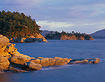San Juan Islands, San Juan County, WA                    <br /> Evening light on sandstone headlands of Sucia Island, a border island and marine state park