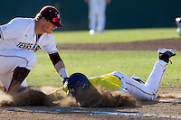Texas State Bobcats first baseman Tanner Hill (42) picks off Michigan Wolverines base runner Jackson Glines (27) during the NCAA season opening baseball game against the Michigan Wolverines on February 14, 2014 at Bobcat Ballpark in San Marcos, Texas. Texas State defeated Michigan 8-7 in 10 innings. (Andrew Woolley/Four Seam Images)