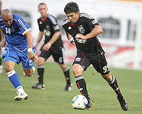 Jaime Moreno #99 of D.C. United moves away from Dennis Alas #14  of El Salvador during an international charity match at RFK Stadium, on June 19 2010 in Washington DC. D.C. United won 1-0.