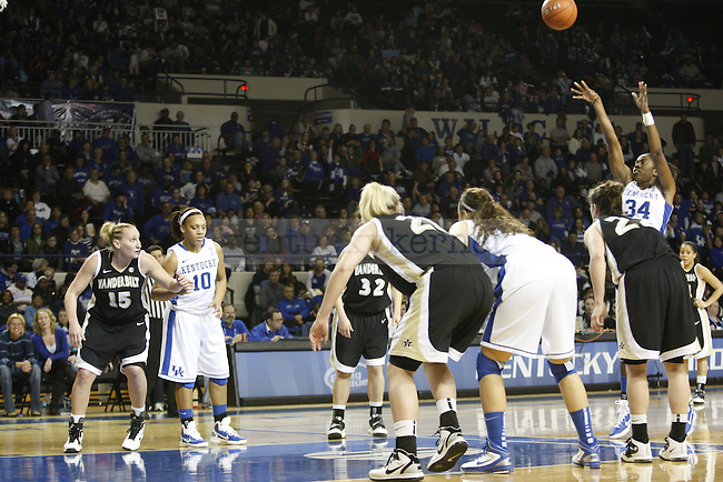 UK's senior forward Victoria Dunlap attempts a free throw as UK and Vanderbilt players prepare for a rebound in the first half of UK Hoops' home game against Vanderbilt, at Memorial Coliseum Jan. 23, 2011. Photo by Collin Lindstrom | Staff.