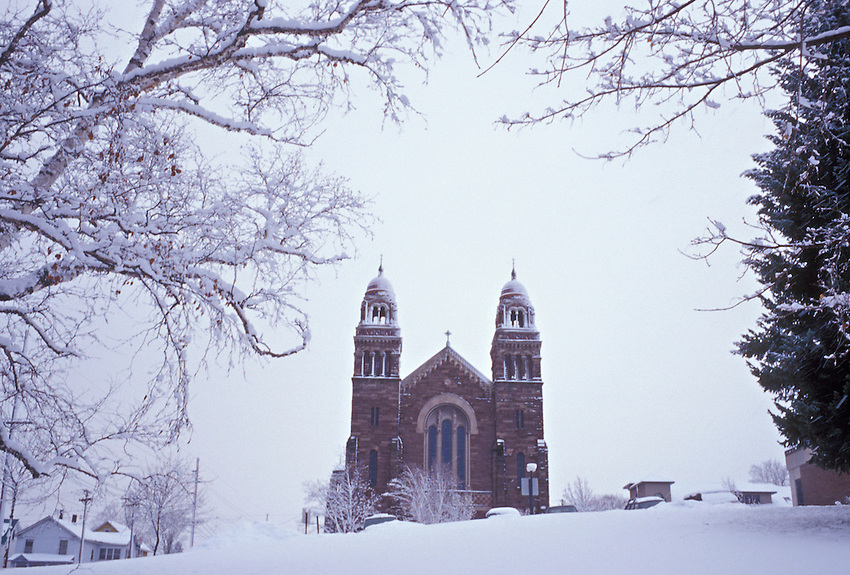 A snowstorm blankets St. Peter Cathedral in Marquette, Mich.