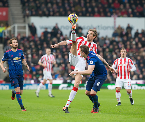 21st January 2017, bet365 Stadium, Stoke-on-Trent, Staffordshire, England; EPL Premiership football Stoke City versus Manchester United;  Peter Crouch of Stoke City with an overhead kick for the ball in front of Phil Jones of Manchester United;