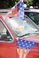 A supporter of Democratic presidential candidate and Hawaii representative Tulsi Gabbard displayed a Pride flag on their pickup truck in the 4th of July parade in Amherst, New Hampshire, on Thu., July 4, 2019.