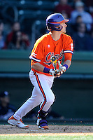 Left fielder Steven Duggar (9) of the Clemson Tigers bats in the Reedy River Rivalry game against the South Carolina Gamecocks on March 1, 2014, at Fluor Field at the West End in Greenville, South Carolina. South Carolina won, 10-2.  (Tom Priddy/Four Seam Images)
