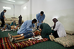Remi OCHLIK/IP3 PRESS - On august, 25, 2011 In Tripoli - Field  hospital in Abu Madi mosq, in Tripoli on August 25, 2011.  Injured soldiers from Abu Selim district frontline are stabilized before going to the closest hospital..