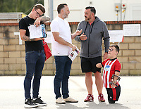 autograph hunting fans wait for Lincoln City players to arrive ahead of kick-off at SIncil Bank<br /> <br /> Photographer Rich Linley/CameraSport<br /> <br /> The EFL Sky Bet League One - Lincoln City v Bristol Rovers - Saturday September 14th 2019 - Sincil Bank - Lincoln<br /> <br /> World Copyright © 2019 CameraSport. All rights reserved. 43 Linden Ave. Countesthorpe. Leicester. England. LE8 5PG - Tel: +44 (0) 116 277 4147 - admin@camerasport.com - www.camerasport.com