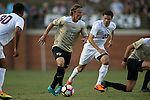 10 September 2016: Wake Forest's Hayden Partain (21) moves between Virginia's Terrell Lowe (23) and Robin Afamefuna (30). The Wake Forest University Demon Deacons hosted the University of Virginia Cavaliers in a 2016 NCAA Division I Men's Soccer match. Wake Forest won the game 1-0 in sudden death overtime.