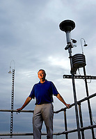 Mecklenburg County Air Monitoring Environmental Specialist David Hord at the Garinger High School monitor station in Charlotte, North Carolina.<br /> <br /> Charlotte Photographer - PatrickSchneiderPhoto.com