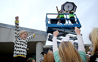 NWA Democrat-Gazette/DAVID GOTTSCHALK  Ellison Clark (from left), a first grade student at Vandergriff Elementary School, sings the Grizzly school song Friday, March 16, 2018 with her classmates and principal Andrea Sego and assistant principal Jay Mirus on a lift in front of the school in Fayetteville. The two administrators spent time on the lift as part of the school's Jump Rope For Heart Celebration. The school raised more than $13,800 through the American Heart Association program aimed at instilling healthy eating and exercise habits in youth.
