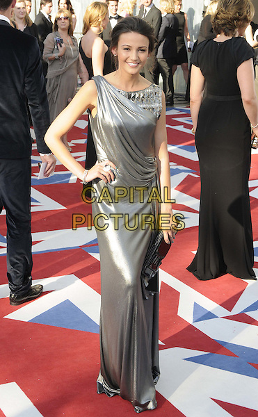 Michelle Keegan.Arrivals at the Arqiva British Academy Television Awards held at the Royal Festival Hall, London, England..May 27th, 2012.BAFTA BAFTAS full length silver silk satin dress hand on hip.CAP/CAN.©Can Nguyen/Capital Pictures.