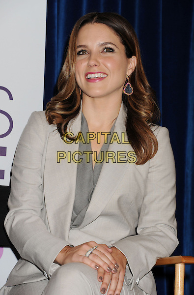 Sophia Bush.The People's Choice Awards 2013 Nomination Announcements at The Paley Center for Media in Beverly Hills, California, USA. .November 15th, 2012.half length smiling sitting grey gray jacket suit beige blazer top gold blue dangling earrings .CAP/ROT/TM.©Tony Michaels/Roth Stock/Capital Pictures