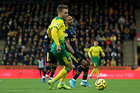1st December 2019; Carrow Road, Norwich, Norfolk, England, English Premier League Football, Norwich versus Arsenal; Pierre-Emerick Aubameyang of Arsenal reacts as Tom Trybull of Norwich City intercepts a pass to him - Strictly Editorial Use Only. No use with unauthorized audio, video, data, fixture lists, club/league logos or 'live' services. Online in-match use limited to 120 images, no video emulation. No use in betting, games or single club/league/player publications