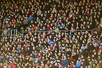 Lincoln City fans watch their team in action<br /> <br /> Photographer Andrew Vaughan/CameraSport<br /> <br /> The EFL Sky Bet League Two - Lincoln City v Stevenage - Saturday 16th February 2019 - Sincil Bank - Lincoln<br /> <br /> World Copyright © 2019 CameraSport. All rights reserved. 43 Linden Ave. Countesthorpe. Leicester. England. LE8 5PG - Tel: +44 (0) 116 277 4147 - admin@camerasport.com - www.camerasport.com