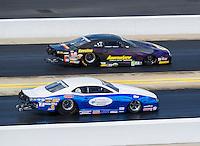 Sep 18, 2016; Concord, NC, USA; NHRA pro stock driver Curt Steinbach (near) races alongside Vincent Nobile during the Carolina Nationals at zMax Dragway. Mandatory Credit: Mark J. Rebilas-USA TODAY Sports