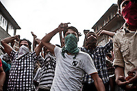 Kashmiri Muslim youth shout pro-Pakistan slogans during a street protest against the Indian rule as they clash with paramilitary Indian forces and police in downtown Srinagar. The separatist Muslim movement claims its independency from India, but the hot line of the Islamic Kashmiris strives to join to Pakistan. Rallies, outcries, stone pelting and daily fightings demand an end of Indian rule in the disputed territory of Kashmir, where anti-India sentiment runs deep among the majority Muslim population. Srinagar, Indian administrated Kashmir.