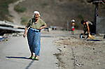 A Roma woman walks through the Maxsuda neighborhood of Varna, Bulgaria, an area where many Turkish-speaking Roma live.