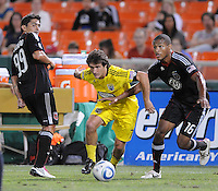 Columbus Crew forward Guillermo Barros Schelotto (7) makes a run cover by DC United defender Jordan Graye (16) right and DC United midfielder Jaime Moreno (99) left.  The Columbus Crew defeated DC united 1-0, at RFK Stadium, Saturday September 4, 2010.