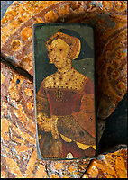 BNPS.co.uk (01202 558833)<br /> Pic: PhilYeomans/BNPS<br /> <br /> The Binney families minature painting of Jane Seymour, on unearthed Tudor tiles on which she may have walked.<br /> <br /> Historic Wolf Hall, home to the Seymour family and star of Hilary Mantel's famous trilogy on Henry VIII th, has finally been definitively located after new discoveries around the much smaller ramshackle house that remains today. <br /> <br /> Despite it's fame, nobody really knew where the enormous Tudor pile actually was, or what it looked like, due to its very short but very influential existance in the middle of the tumultuous 16th century.<br /> <br /> Built with a million pound loan (&pound;2,400) from King Henry in 1531, brokered by Thomas Cromwell, the huge house was rapidly brick built in time for the King's pivotal visit with the court and troublesome wife Anne Boleyn in 1535, at which point Sir John Seymour's daughter Jane caught his eye, within a year Anne was dead and Jane, and the rest of the Seymour clan were in.<br /> <br /> They benefitted massively from Royal patronage and the dissolution of the monastries, but it all went wrong when Henry died and the brothers fell out and were later executed in a spectacular fall from power only 21 years after the house was built.<br /> <br /> Historian Graham Bathe and his team have now uncovered part of the outline of the original building, as well as the extensive Tudor brick sewer system that proves the huge scale of the 16th century mansion.