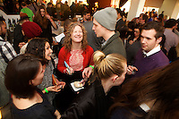 New York, NY - March 18, 2015: Guests take a break from the snacks and drinks at Good Cider, a food and hard cider tasting hosted by Edible Manhattan in Tribeca. <br /> <br /> CREDIT: Clay Williams for Edible Manhattan.<br /> <br /> &copy; Clay Williams / claywilliamsphoto.com