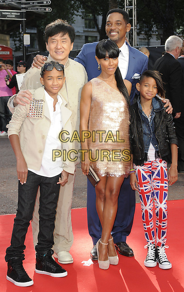 "JADEN SMITH, JACKIE CHAN, JADA PINKETT SMITH, WILL SMITH & WILLOW SMITH .The Gala Premiere of ""The Karate Kid"", Odeon Leicester Square, London, England, UK. .15th July 2010 .full length beige suit top jacket shirt white t-shirt studs studded leather black pink paillettes discs dress one shoulder shiny sunglasses shades family parents kids children mom mum dad mother father sister siblings married husband wife blue suit tie checked check plaid tartan union jack flag print pants trousers converse trainers .CAP/CAN.©Can Nguyen/Capital Pictures."
