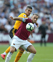 West Ham United's Marko Arnautovic and Wolverhampton Wanderers' Conor Coady<br /> <br /> Photographer Rob Newell/CameraSport<br /> <br /> The Premier League - West Ham United v Wolverhampton Wanderers - Saturday 1st September 2018 - London Stadium - London<br /> <br /> World Copyright © 2019 CameraSport. All rights reserved. 43 Linden Ave. Countesthorpe. Leicester. England. LE8 5PG - Tel: +44 (0) 116 277 4147 - admin@camerasport.com - www.camerasport.com
