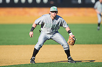Marshall Thundering Herd third baseman Aaron Bossi (17) on defense against the Georgetown Hoyas at Wake Forest Baseball Park on February 15, 2014 in Winston-Salem, North Carolina.  The Thundering Herd defeated the Hoyas 5-1.  (Brian Westerholt/Four Seam Images)