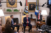 United States President Donald J. Trump, right, answers a reporter's question as he greets Prime Minister Kyriakos Mitsotakis of Greece, left, in the Oval Office of the White House in Washington, D.C. on Tuesday, January 7, 2020.     <br /> Credit: Tasos Katopodis / Pool via CNP/AdMedia