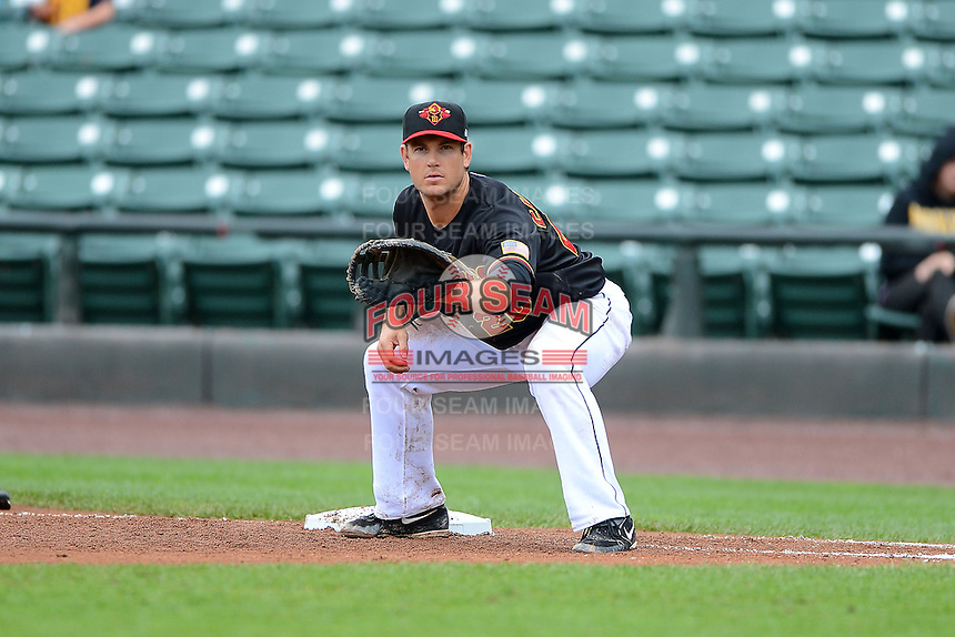 Rochester Red Wings first baseman Jeff Clement #20 during a game against the Toledo Mudhens on June 11, 2013 at Frontier Field in Rochester, New York.  Toledo defeated Rochester 9-5.  (Mike Janes/Four Seam Images)