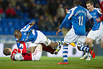 St Johnstone v Aberdeen.....30.01.13      SPL.Gregory Tade is brought down by Mark Reynolds.Picture by Graeme Hart..Copyright Perthshire Picture Agency.Tel: 01738 623350  Mobile: 07990 594431