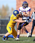 BROOKINGS, SD - OCTOBER 26:  T.J. Lally #33 from South Dakota State University brings down Chad Owens #19 from Northern Iowa in the first quarter of their game Saturday afternoon at Coughlin Alumni Stadium in Brookings. (Photo by Dave Eggen/Inertia)