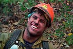 August 15, 1990 Yosemite National Park  --  A-Rock (Arch Rock) Fire  --  Scott Crisco, a sawyer on the Mendocino Hotshots, laughs at a joke during a break from cutting line.  The Arch Rock Fire burned over 16,000 acres of Yosemite National Park and the Stanislaus National Forest.  At the same time across the Merced River, the Steamboat Fire burned over 5,000 acres of both Yosemite National Park and the Sierra National Forest.