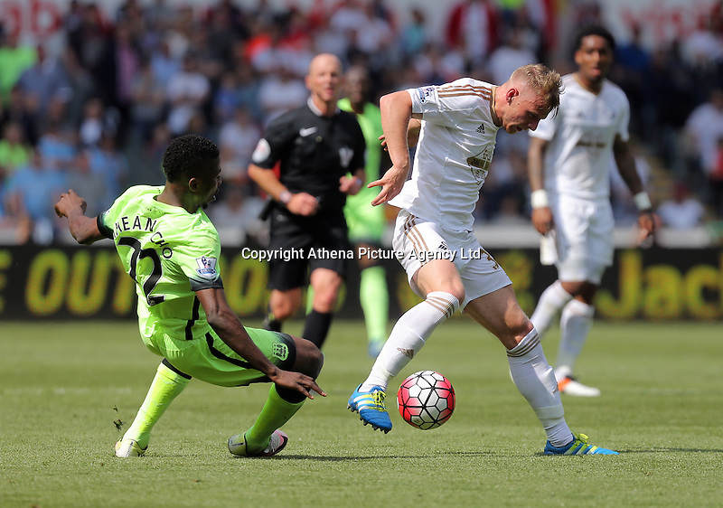 ( L-R ) Kelechi Iheanacho of Manchester City is tackled by Stephen Kingsley of Swansea City during the Swansea City FC v Manchester City Premier League game at the Liberty Stadium, Swansea, Wales, UK, Sunday 15 May 2016