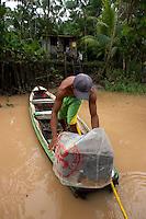 O pescador Rogério Silva, 28 anos, dois filhos, nasceu no rio Aurá e mesmo sem poder pescar não quer abandonar seu patrimônio.<br /> Nas matas da á́rea de Proteção Ambiental de Belém (APA-BELÉM)  o pequeno igarapé conhecido como Boca do Santana,  tras em suas águas o  chorume  produzido pelo lixão do Aurá. Cerca  2 mil toneladas de lixo  são coletados  de  450 mil residências diariamente e depositados  a céu aberto sem nenhum tratamento .  .<br /> A área  de  7.500 ha, abriga ainda os lagos Bolonha e Água Preta que abastecem de água para os muniípios de Belém e Ananindeua também sofrem com a contaminação atraves dos lencóis freáticos e pela captação das águas próximo ao rio Aurá. <br /> Belém, Pará, Brasil<br /> Foto Paulo Santos<br /> 19/03/2013