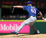 Texas Rangers' reliever Anthony Bass pitches against the Seattle Mariners at SAFECO Field in Seattle on April 10, 2015.  The Mariners came from behind to beat the Rangers 11-10.  Jim Bryant Photo. ©2015. All Rights Reserved.