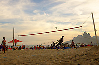 people play volley football over a net on Ipanema beach in Rio de Janiero