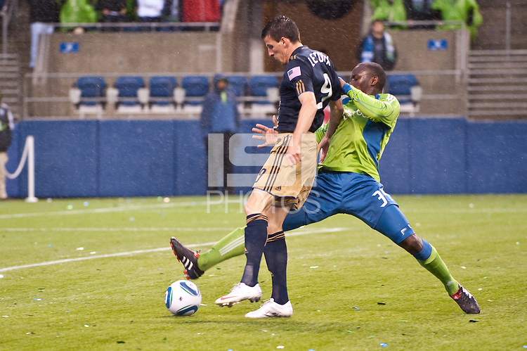 Sebastien Le Toux (l) and Jhon Kennedy Hurtado (r) struggle for the wet ball as the Seattle Sounders defeated the Philadelphia Union, 2-0, in an MLS match on Thursday, March 25, 2010 at Qwest Field in Seattle, WA. It was the Sounders home opener and the first regular season game for the expansion Philadelphia Union.