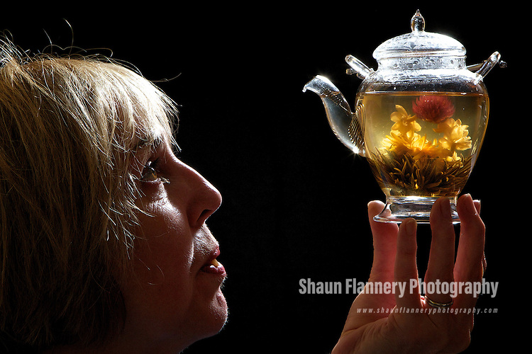 Pix: Shaun Flannery/shaunflanneryphotography.com...COPYRIGHT PICTURE>>SHAUN FLANNERY>01302-570814>>07778315553>>..17th May 2011...............The Tea Experience, 6 South Parade, Doncaster..Ann Davies pictured with a Flowering Tea Bloom.